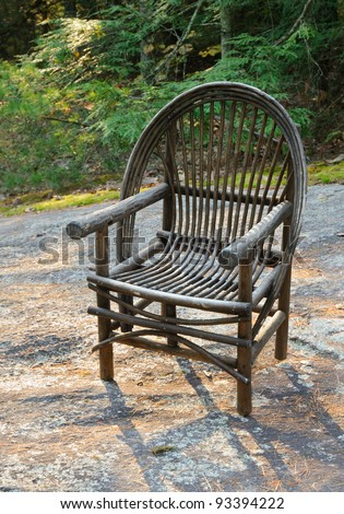 wicker chair on a flat rock