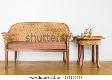Wicker chairs are placed in the living room. - stock photo