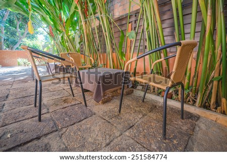 Wicker chairs with table outdoor - stock photo