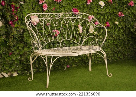 wicker couch in a garden - stock photo