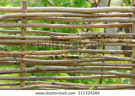 Wicker Fence in the Garden - stock photo
