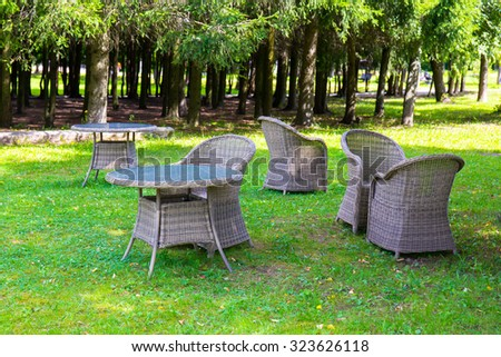 Wicker furniture armchair at green city park recreation - stock photo