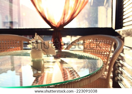 wicker furniture in a summer cafe interior - stock photo