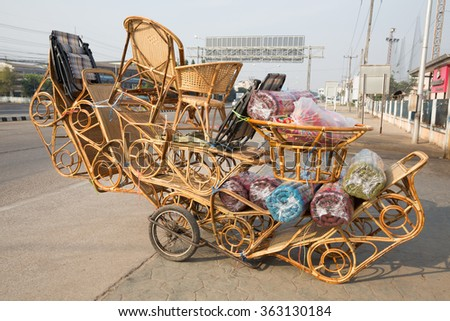 wicker furniture loading on small car wheels for sale in Thailand - stock photo