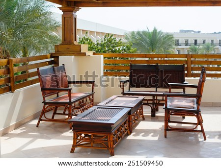 wicker furniture on the balcony. - stock photo
