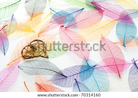 Wicker heart on a carpet of colorful leaves