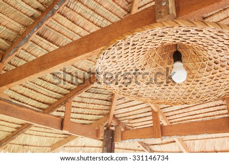 wicker lamp in the interior - stock photo