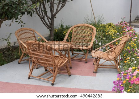 Wicker Or Cane Chairs. Rattan Chair Set In The Garden. Image In Natural  Light