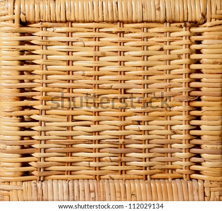 Wicker pattern obtained from the bottom of a square wicker basket. - stock photo