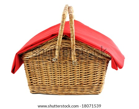 wicker picnic basket with red tablecloth - stock photo