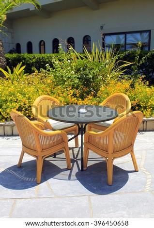 wicker seats on the mediterranean hotel terrace, Crete, Greece - stock photo