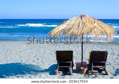 Wicker umbrella on the beach in Limassol, Cyprus - stock photo
