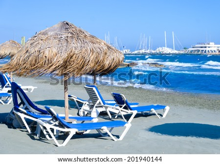 Wicker umbrellas on the beach in Limassol, Cyprus - stock photo
