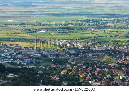 Wide aerial view of Brasov suburbs, Romania. - stock photo