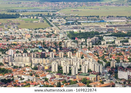 Wide aerial view of residential suburbs of Brasov city, Romania. - stock photo