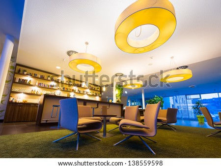 wide angel of modern lounge in hotel bar with huge lamps - stock photo