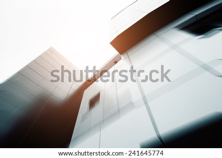 Wide angle abstract background view of steel light blue high rise commercial building skyscraper made of glass exterior. concept of successful industrial architecture and office center building - stock photo