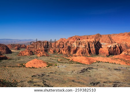 Wide-angle aerial view of Snow Canyon State Park from an overlook nearby St. George, Utah. - stock photo