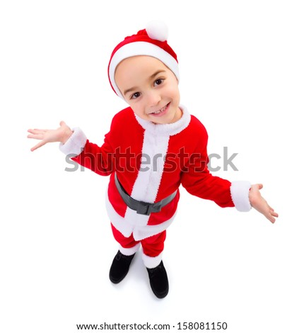 Wide angle funny boy wearing Santa Claus uniform
