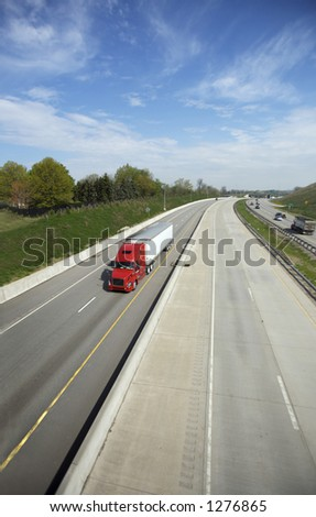 Wide Angle (16mm) shot of Semi on the Highway with Copy Space - stock photo