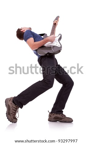 wide angle of a young guitarist playing on white baclground - stock photo