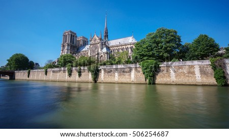 Wide angle of Notre dame and Seine river (rear view), long exposure, silk water, Paris