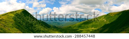 wide angle panoramic view on the glacier range and valley in Ukrainian Carpathians - stock photo