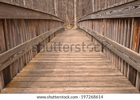 Wide-angle photo of a wood bridge from Cunningham Falls State Park in Maryland, USA. HDR composite from multiple exposures. - stock photo