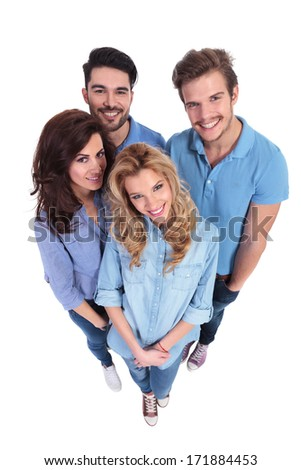 wide angle picture of group of casual people smiling to the camera on white background