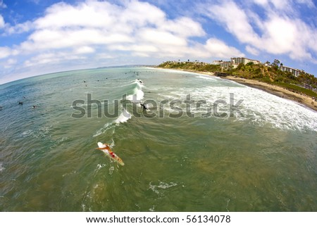 Wide Angle San Clemente Surfing from the Pier looking North - stock photo