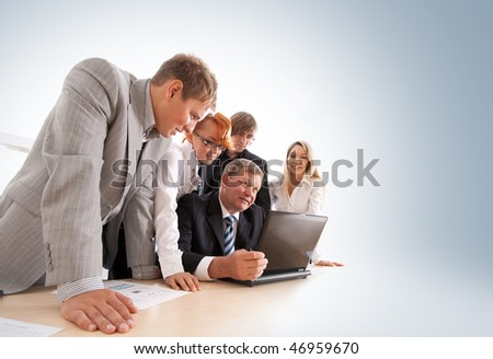 Wide angle shoot of business group of two young ladies, two young men and a mature boss at work - stock photo