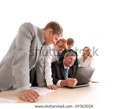 Wide angle shoot of business group of two young ladies, two young men and a mature boss at work isolated on white - stock photo