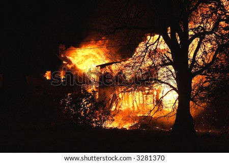 Wide angle shot of a night-time fire in Detroit - stock photo