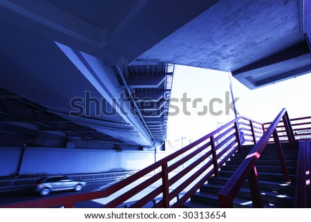 Wide angle shot of stairs to bridge toned in blue color