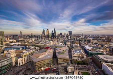 Wide angle skyline view of east London with the famous financial Bank district and beautiful clouds - London, UK - stock photo