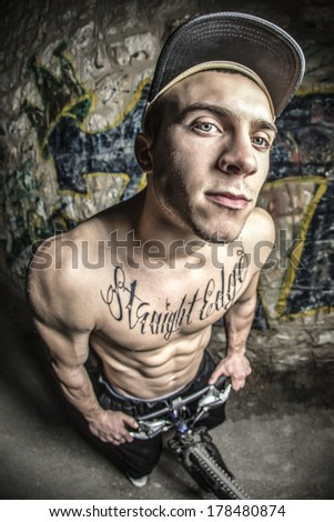 Wide angle  street portrait of young strong man  - stock photo