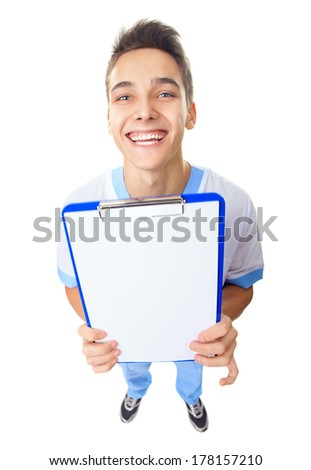 Wide angle top view of  happy laughing young doctor showing empty clipboard isolated on white background - stock photo