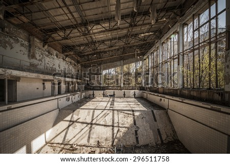 Wide-angle view of an abandoned swimming pool of Pripyat. Chernobyl nuclear power plant zone of alienation
