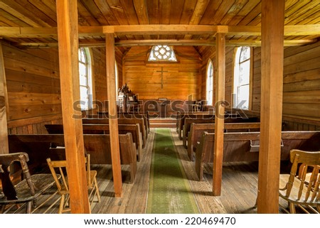 wide angle view of an old wooden mining town church interior in British Columbia ,Canada  - stock photo