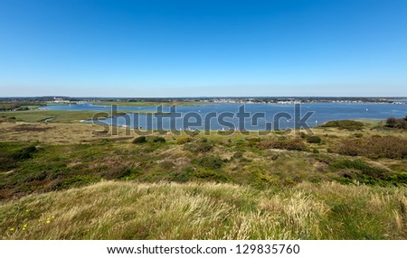 Wide angle view of Christchurch Harbour, Dorset and Harbour from Hengistbury Head - stock photo
