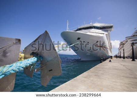 wide angle view of cruise ship in port, focus on foreground - stock photo