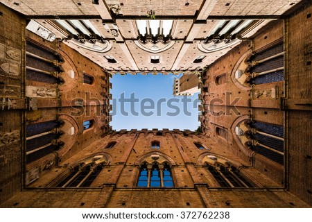 Wide angle view of famous Torre del Mangia in Siena, Tuscany, Italy