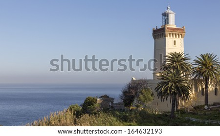 Wide angle view of lighthouse in Morocco with atlantic ocean