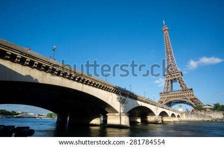 Wide angle view of The Eiffel Tower, bridge and Seine river, long exposure in Paris, France - stock photo