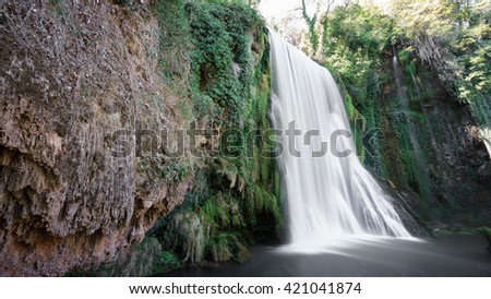 Wide angle view of waterfall at Monasterio de Piedra in Spain, long exposure - stock photo