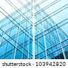 wide angle view to blue texture of  light glass buildings in business center - stock photo
