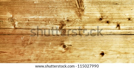 Wide angle view to bright grungy wooden desk - stock photo