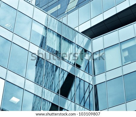 Wide angle view to textured background of modern glass skyscraper