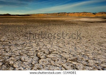 Wide angle vista of a dry lake bed in the California desert.