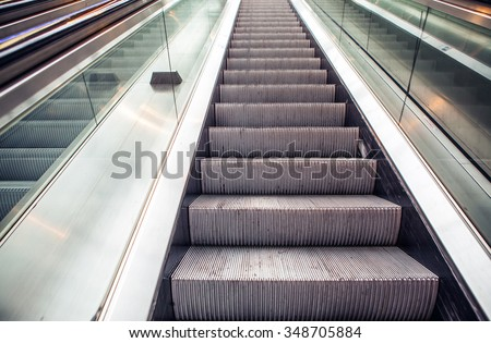 Wide angled view to perspective escalators stairway.